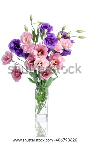 bunch of violet, white and pink eustoma flowers in glass vase isolated on white - stock photo
