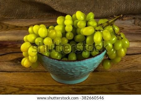 Bunch of white grapes on a dark wooden background. Cluster of grapes. Bunch of grapes. Custer grapes. Bunch grapes. Grapes. Grape - stock photo