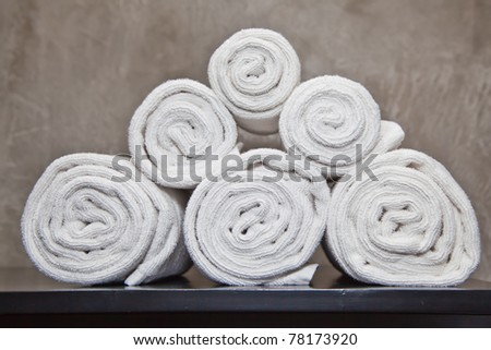 bunch of white towels in bathroom shelf - stock photo