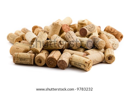 bunch of wine corks scattered on white background - stock photo