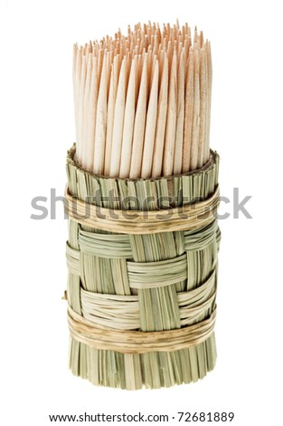 Bunch of wooden toothpick in round wattled straw holder, isolated on white - stock photo