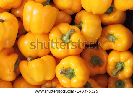 Bunch of yellow peppers for sale in a greengrocery - stock photo
