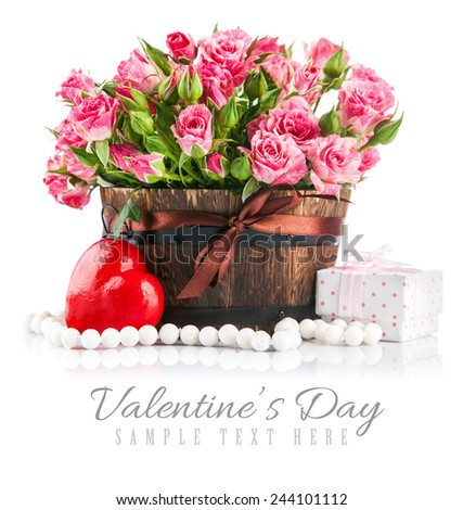Bunch pink roses with gift to day saint valentine. Isolated on white background - stock photo