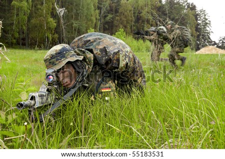 Bundeswehr soldiers conducting military operations. - stock photo