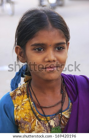 BUNDI, INDIA - FEBRUARY 4: An unidentified girl walks in the street on February 4, 2011 in Bundi, India. Bundi is a popular place of attraction and tourism industry primarily supports its economy.  - stock photo