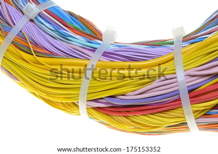 Bundle of cables with cable ties isolated on white background - stock photo