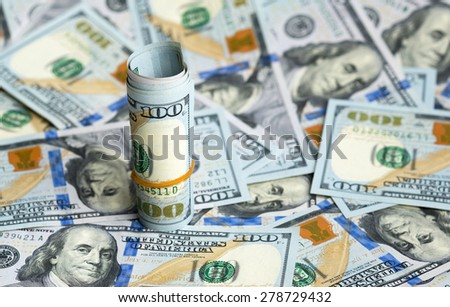bundle of dollars on bills spilling - stock photo