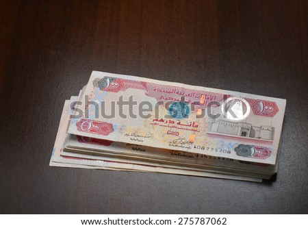 Bundle of Hundred dirhams currency notes on dark background. - stock photo