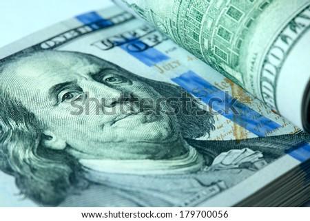Bundle of hundred dollar bills xlose-up - stock photo