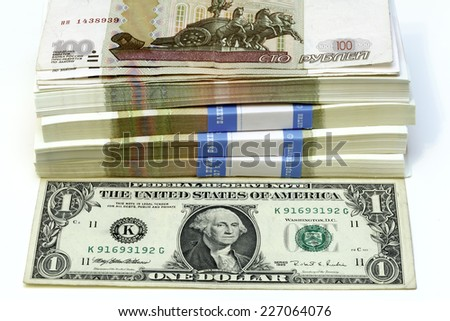 bundle of hundred-ruble notes to one Dolar - stock photo