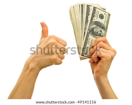 Bundle of money in the hand - symbol of success in business - stock photo