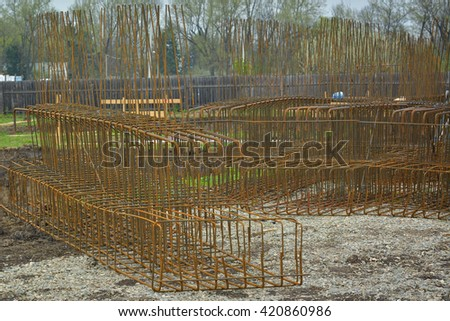 bundle of reinforced components in a construction site - stock photo