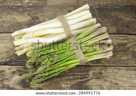 bundle of white and green asparagus on board - stock photo