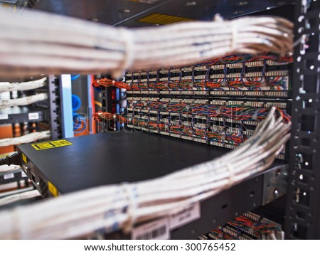 Bundled wires connecting to servers - stock photo