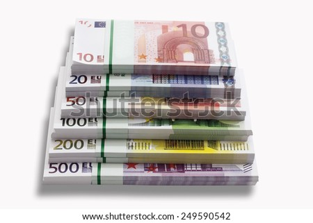Bundles of Euro banknotes on white background, close-up - stock photo