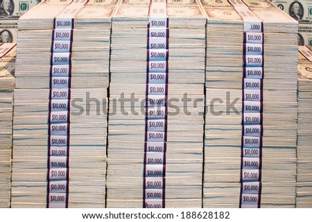 Bundles of money stacked on top of each other - stock photo
