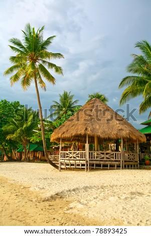 bungalow at the coastline - stock photo