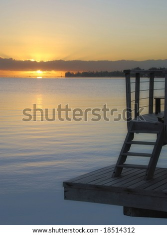 Bungalow deck at sunrise - stock photo