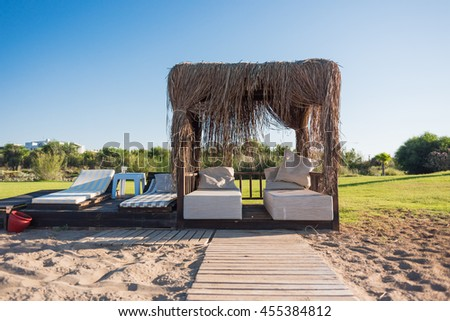 Bungalow with sun loungers - stock photo