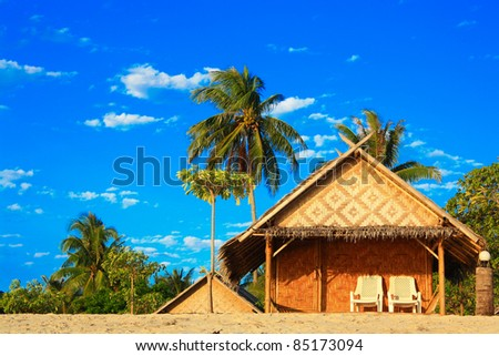 Bungalows on beach and sand