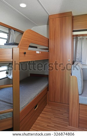 Bunk Bed And Closet in Camping Trailer