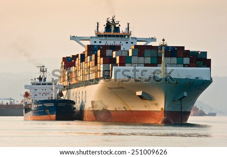 Bunkering tanker Vitaly Vanyhin a container ship COSCO Phillipines. Nakhodka Bay. East (Japan) Sea. 01.08.2014 - stock photo