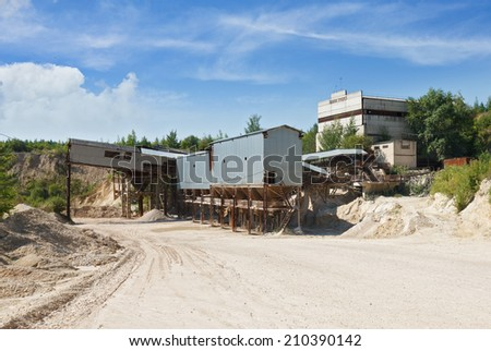 bunkers on stone crusher limestone quarry - stock photo