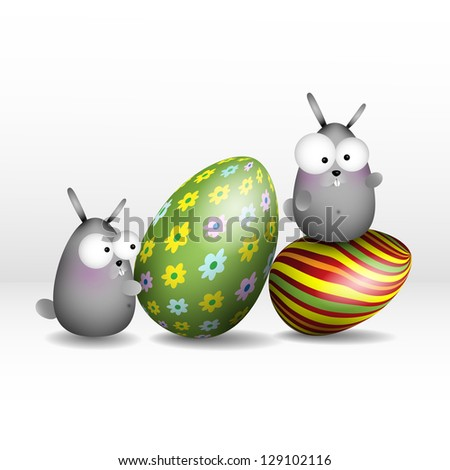 Bunny with easter eggs. - stock photo
