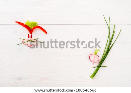 Bunny with vegetables on white wooden table - stock photo