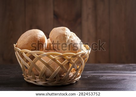 buns in a basket on a wooden table - stock photo