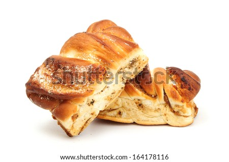 Buns with poppy seeds on white background