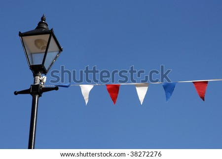 Bunting hanging from streetlight on Broadstairs seafront - stock photo