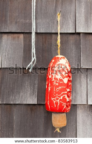 Buoy hanging on wall in Mystic, Connecticut, New England, United States of America, North America - stock photo