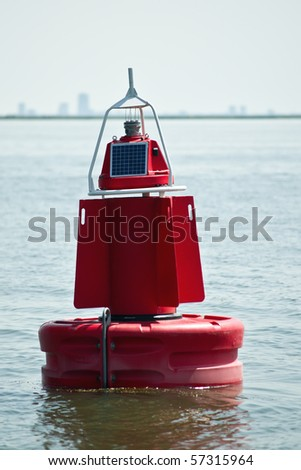 Buoy marking the navigable depth in the Netherlands. - stock photo
