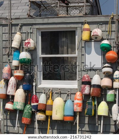 Buoys hanged on wooden wall - stock photo
