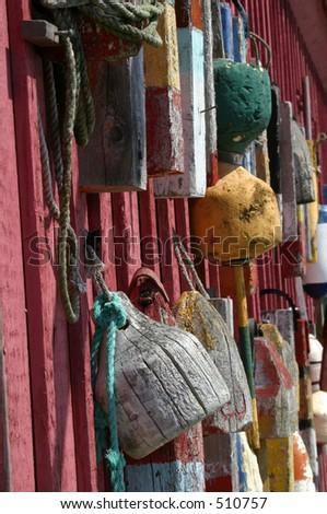 Buoys on historical building in Rockport Massachusetts - stock photo