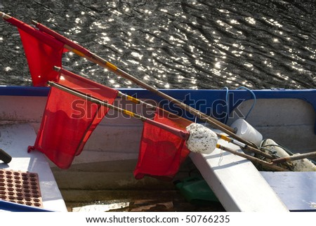 Buoys with flags for fishing. Limfjord, Denmark - stock photo
