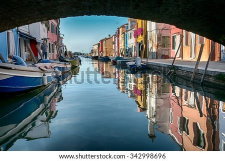 BURANO, ITALY CIRCA SEPTEMBER 2015: Burano is an island in the Venice lagoon known for its typical brightly colored houses and the centuries-old craftsmanship needle lace of Burano. - stock photo