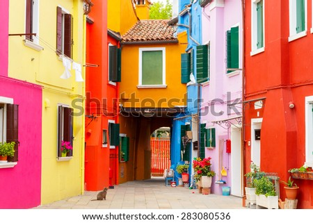 Burano, Italy - May 21 2015: The island in the lagoon near Venice. Famous tourist attraction. Famous for its colorful houses and lace.