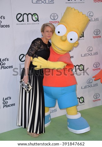 BURBANK, CA - OCTOBER 24, 2015: Simpson's voice actress Yeardley Smith & Bart Simpson character at the 25th Annual Environmental Media Awards at Warner Bros. Studios, Burbank - stock photo