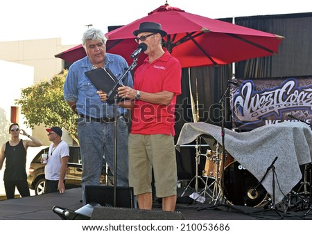 BURBANK/CALIFORNIA - JULY 26, 2014: Jay Leno former host of Tonight Show is awarded a Lifetime Achievement Award from City of Burbank at the Burbank Car Classic July 26, 2014, Burbank, California USA  - stock photo