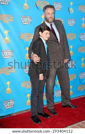 BURBANK - JUNE 25: Lance Guest and son arrive at the 41st Annual Saturn Awards on Thursday, June 25, 2015 at the Castaway Restaurant in Burbank, CA. - stock photo