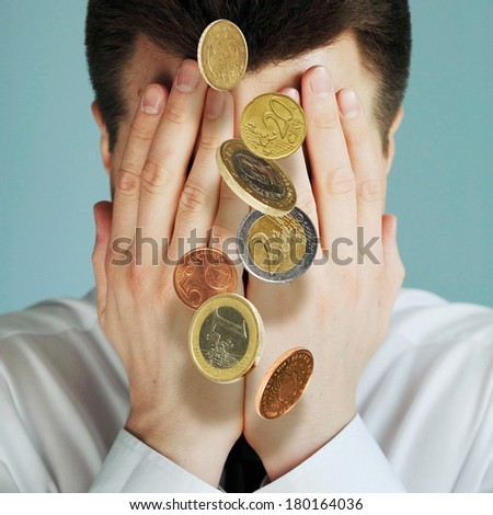 Bureaucrat hiding face from Euro coins rain - stock photo