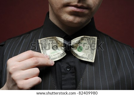 bureaucrat with bowtie made from dollar - stock photo
