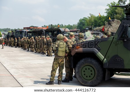 BURG / GERMANY - JUNE 25, 2016: german soldiers stands on army convoy at open day in barrack burg / germany on june 25, 2016