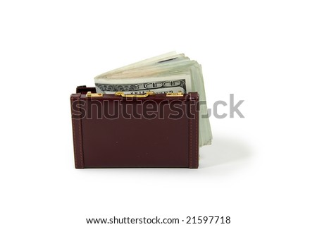 Burgandy leather suitcase used to carry items to the office, Money in the form of many large bills - stock photo