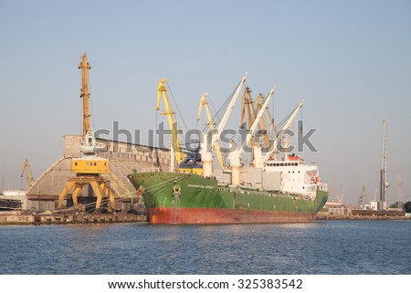 Burgas - August 28: Cranes handled cargo ship in the port of August 28 2015 Bourgas, Bulgaria