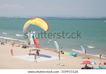 Burgas - July 24: Race suit landing paraglider - yellow paraglider lands in the goal on the beach on July 24 to 26, 2015 July 24, 2015, Burgas, Bulgaria