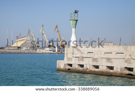Burgas - October 25: View from the small harbor lighthouse amid sea, cranes, buildings and blue sky on October 25, 2015 Bourgas, Bulgaria