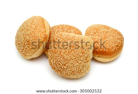 burger buns with sesame seeds on top isolated on white
